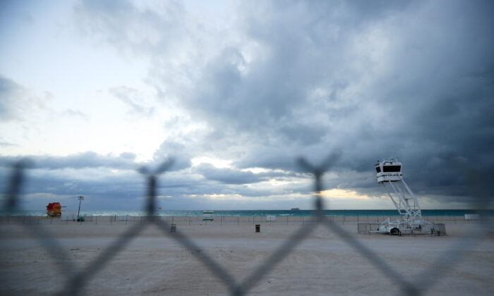 A mobile police tower overlooks an area of South Beach that the city closed in an effort to prevent the spread of the coronavirus in Miami Beach, Florida on March 17, 2020. Miami Beach city officials closed the area of the beach that is popular with college spring breakers and asked them to refrain from large gatherings where COVID-19 could spread. (Cliff Hawkins/Getty Images)