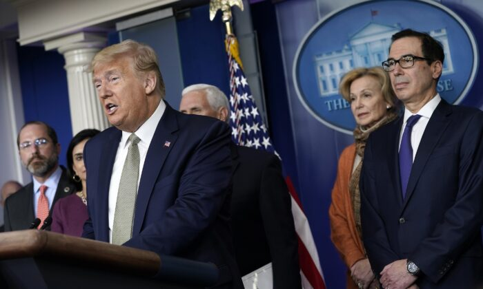 President Donald Trump speaks as administration officials listen in the press briefing room at the White House in Washington on March 17, 2020. (Drew Angerer/Getty Images)