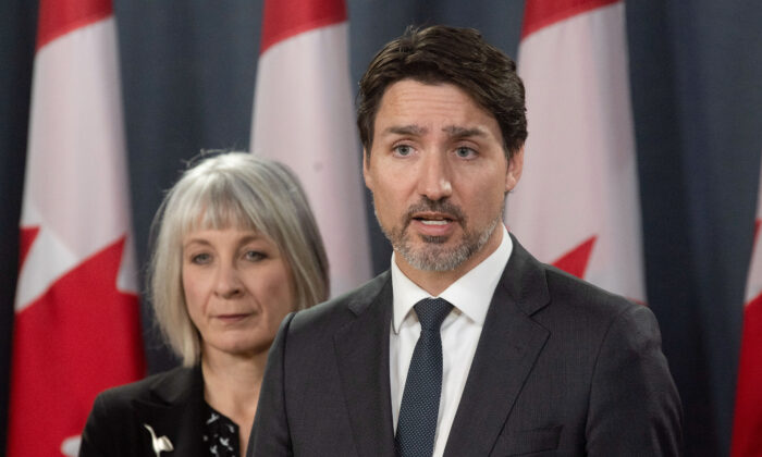 Minister of Health Patty Hajdu looks on as Prime Minister Justin Trudeau speaks during a news conference  in Ottawa, Canada, on March 11, 2020. (Adrian Wyld/The Canadian Press via AP)