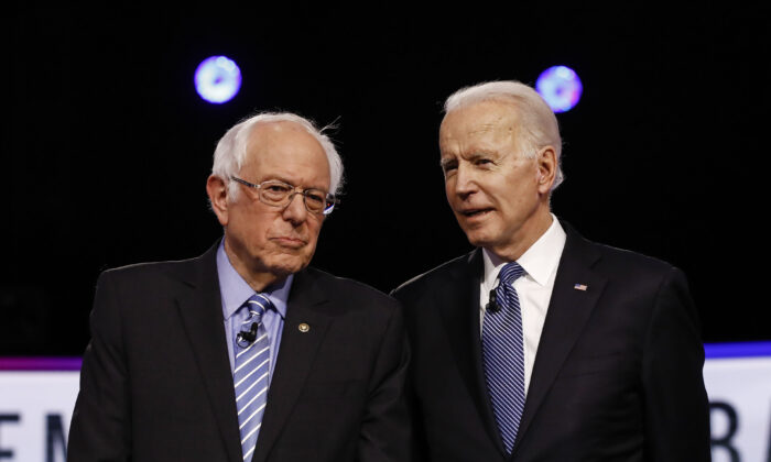 Democratic presidential candidates, Sen. Bernie Sanders (I-Vt.) (L) and former Vice President Joe Biden, talk before a Democratic presidential primary debate in Charleston, S.C., on Feb. 25, 2020. (Matt Rourke/AP Photo)