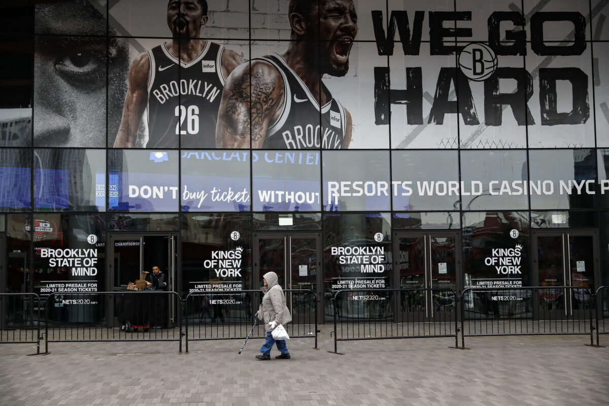 A pedestrian passes an entrance to the Barclays Center
