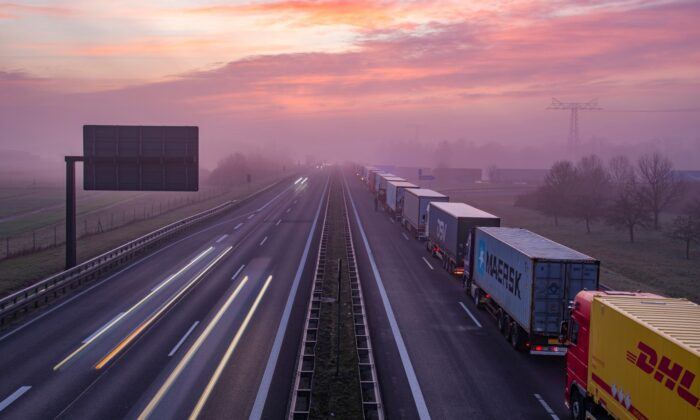 Trucks are jammed in the early morning on Autobahn 12 in front of the German-Polish border crossing near Frankfurt (Oder), Germany, on March 18, 2020. (Patrick Pleul/dpa via AP)
