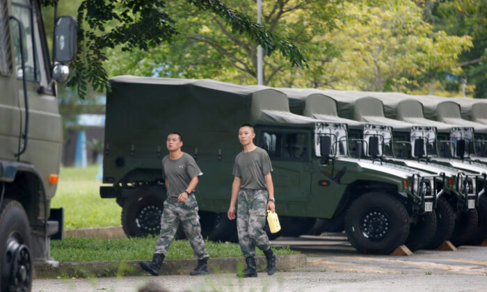Troops are seen at the Shek Kong military base of People's Liberation Army (PLA) in New Territories, Hong Kong, China, on Aug. 29, 2019. (Reuters)