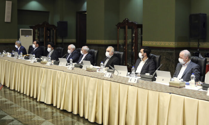 Cabinet members wearing masks attend their meeting in Tehran, Iran, on March 18, 2020. (Office of the Iranian Presidency via AP)