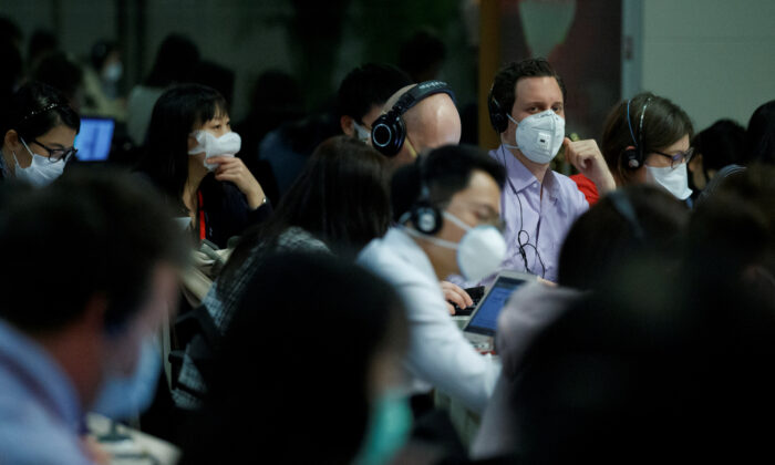 Journalists attend the daily press briefing of the Chinese Foreign Ministry in Beijing on March 18, 2020. (Thomas Peter/Reuters)