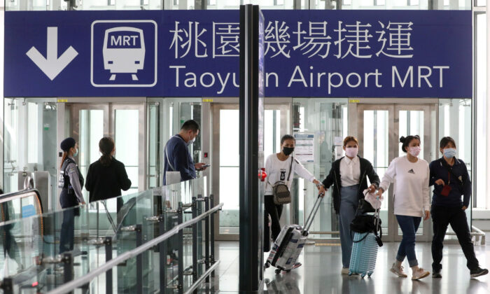 Travelers arrive at the airport as the Taiwanese government announced a ban for most foreigners entering the island, as part of preventive measures against coronavirus disease (COVID-19), at Taoyuan International airport in Taoyuan, Taiwan, on March 18, 2020. (Ann Wang/Reuters)