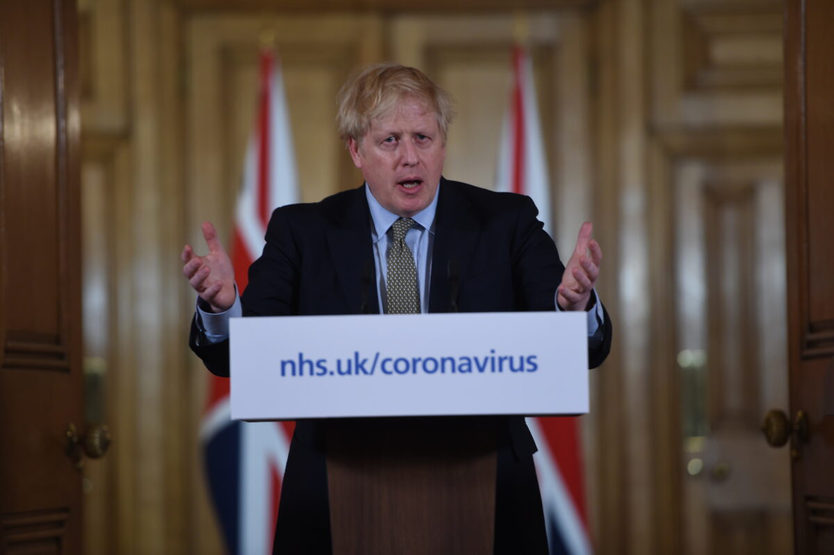 British Prime Minister Boris Johnson gestures