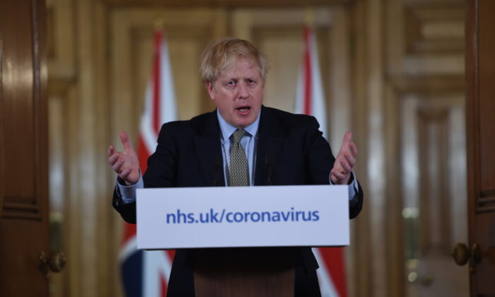 British Prime Minister Boris Johnson gestures as he gives a press conference about the ongoing situation with the COVID-19 outbreak inside 10 Downing Street in London, England, on March 18, 2020. (Eddie Mulholland/WPA Pool/Getty Images)