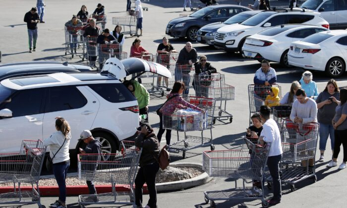 A line of people waiting to buy supplies amid coronavirus fears snakes through a parking lot at a Costco in Las Vegas on March 14, 2020. (John Locher/AP Photo)