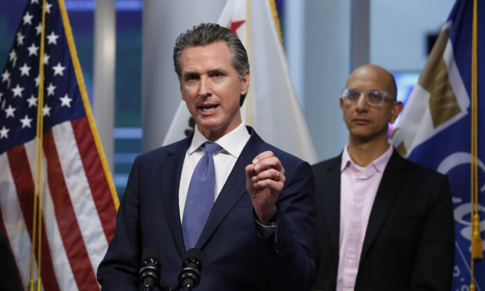 California Gov. Gavin Newsom gives an update on the state's response to the COVID-19 pandemic, at the Governor's Office of Emergency Services in Rancho Cordova, Calif., on March 17, 2020. At right is California Health and Human Services Agency Director Dr. Mark Ghaly. (Rich Pedroncelli, Pool/AP Photo)