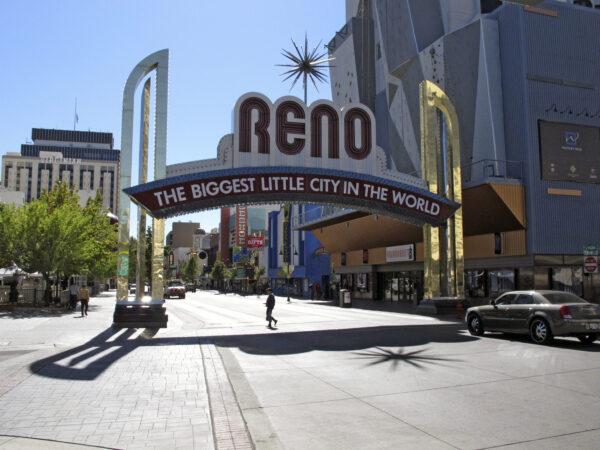 Pedestrians pass beneath the Reno