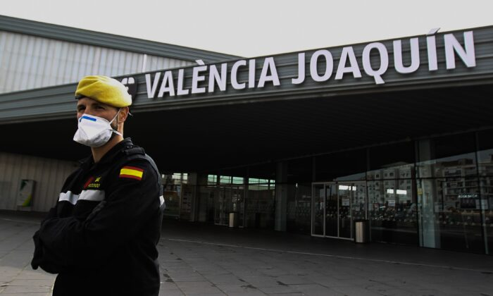 Members of the Military Emergencies Unit control access to the Joaquin Sorolla railway station in Valencia, Spain, on March 18, 2020. (Jose Jordan/AFP via Getty Images)