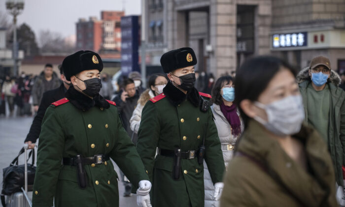 Chinese police officers wear protective masks as they patrol at Beijing Station before the annual Spring Festival on Jan. 22, 2020, in Beijing. (Kevin Frayer/Getty Images)