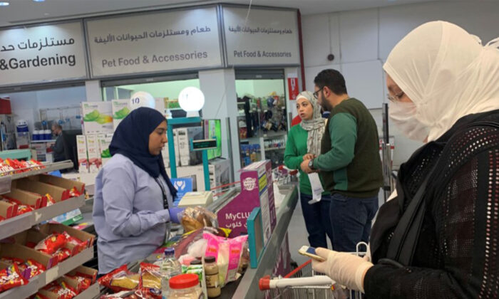 A woman wears a protective face mask inside a Carrefour hypermarket while Egypt ramps up its efforts to slow the spread the CCP virus disease (COVID-19) in Cairo, Egypt, on March 19, 2020.(Amr Abdallah Dalsh/REUTERS)