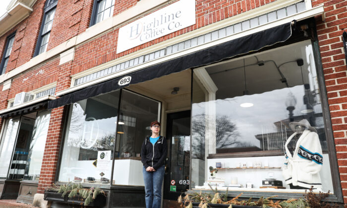 Christie Bruffy, owner of Highline Coffee Co., stand outside her shop in the City of Worthington in Columbus, Ohio, on March 18, 2020. (Charlotte Cuthbertson/The Epoch Times)