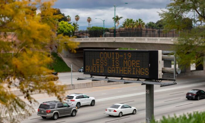 A Caltrans Changeable Message Sign (CMS) warns motorists on the Interstate 5 freeway in Anaheim, Calif., on March 14, 2020. (David McNew/AFP via Getty Images)