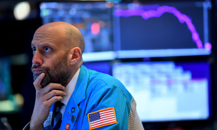 A trader works during the opening bell at the New York Stock Exchange on Wall Street in New York City on March 19, 2020. (Johannes Eisele/AFP via Getty Images)