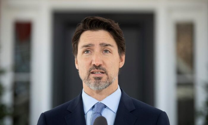 Prime Minister Justin Trudeau speaks to the media during a news conference about the COVID-19 virus outside Rideau Cottage in Ottawa, on March 18, 2020. (The Canadian Press/Adrian Wyld)