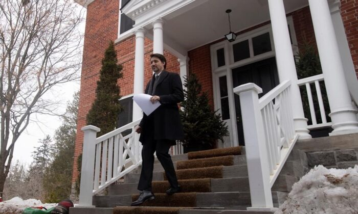 Prime Minister Justin Trudeau makes his way down the steps of Rideau Cottage to a podium for a daily briefing on measures Canada is taking to fight the COVID-19 virus in Ottawa, on March 19, 2020. (Adrian Wyld/The Canadian press)