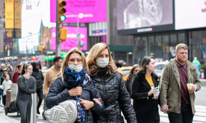 People wear disposable face masks near Times Square, New York, on March 11, 2020. (Chung I Ho/The Epoch Times)