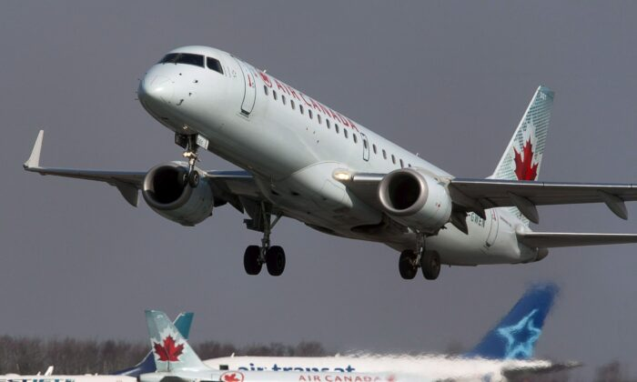 An Air Canada jet takes off from Halifax Stanfield International Airport in Enfield, N.S., in a file photo. A union official says Air Canada is laying off more than 5,000 flight attendants as the country's largest airline cuts routes and parks planes due to COVID-19. (The Canadian Press/Andrew Vaughan)
