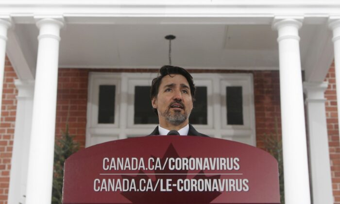 Prime Minister Justin Trudeau speaks to the media about the COVID-19 pandemic during a news conference outside Rideau cottage in Ottawa on March 20, 2020. (The Canadian Press/Adrian Wyld)