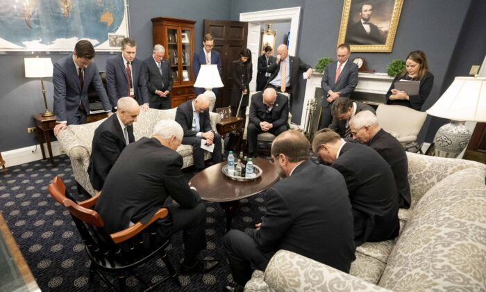 Vice President Mike Pence prays with the President's Coronavirus Taskforce in his West Wing Office of the White House on Feb. 26, 2020. (Official White House Photo by D. Myles Cullen)