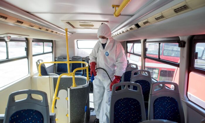 A worker disinfects a public bus against COVID-19 in Skopje, North Macedonia, on Feb. 29, 2020. (Robert Atanasovski/AFP via Getty Images)