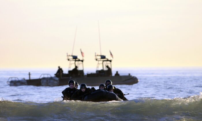 Students in SEAL qualification training navigate the surf during a maritime operations training exercise in Coronado, California, on Oct. 28, 2010  (Blake Midnight/US Navy via Getty Images)