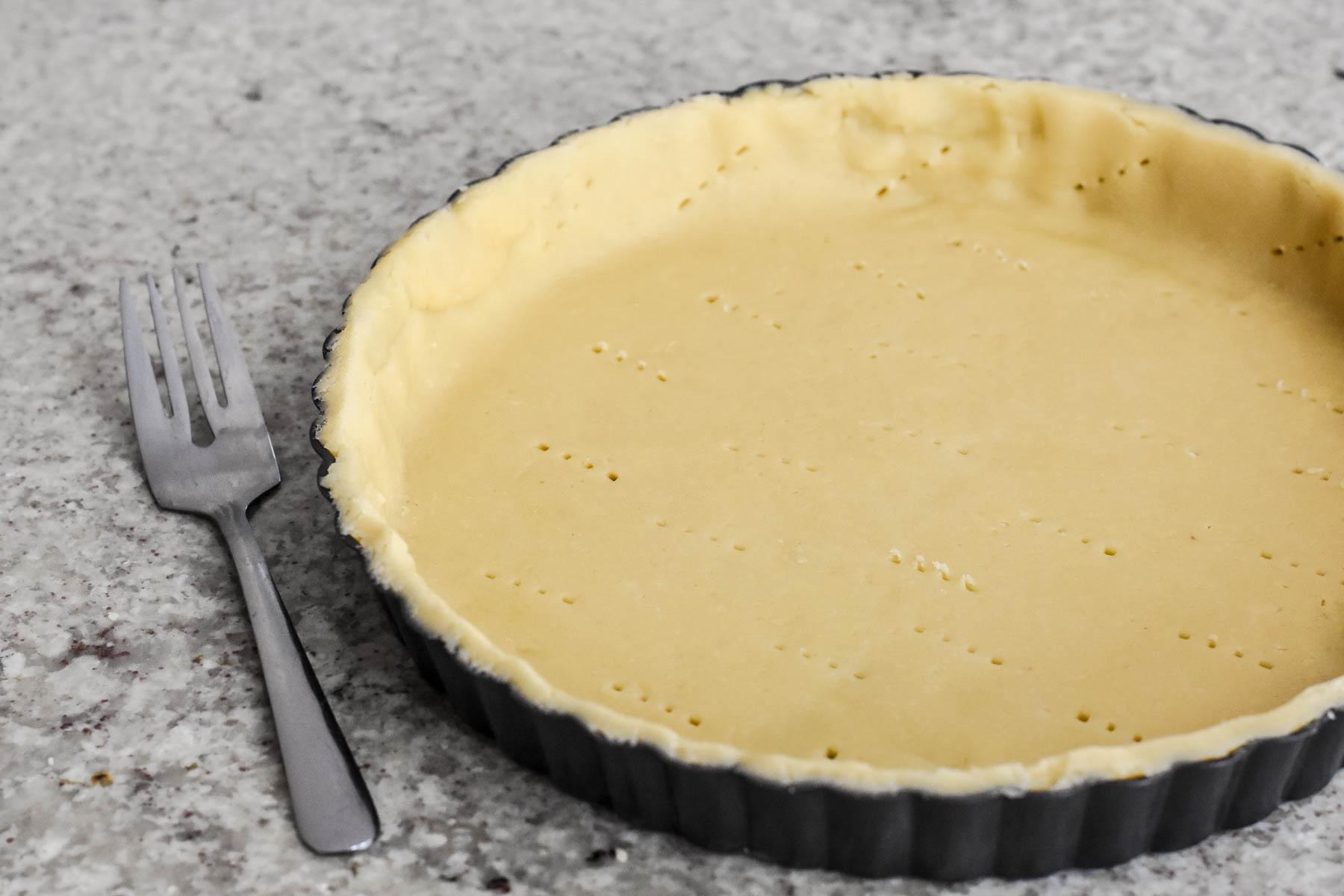Tarte au Citron - poking holes in the pate sucree