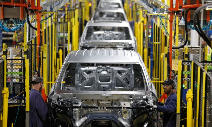 Workers assemble cars at the newly renovated Ford's Assembly Plant in Chicago, June 24, 2019. (Jim Young/AFP via Getty Images)