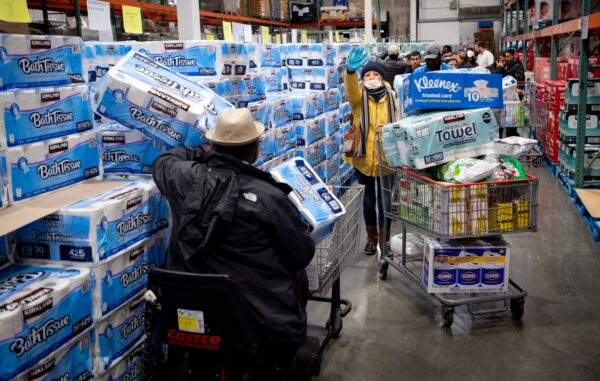 People shop for toilet paper