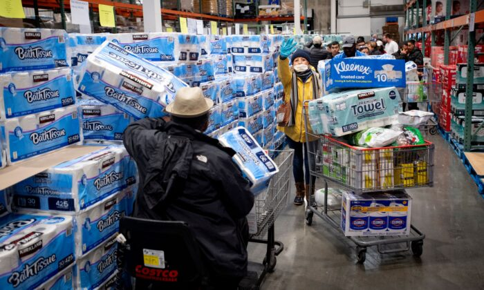 People shop for toilet paper at a Costco store in Novato, Calif., on March 14, 2020. (Josh Edelson/AFP via Getty Images)