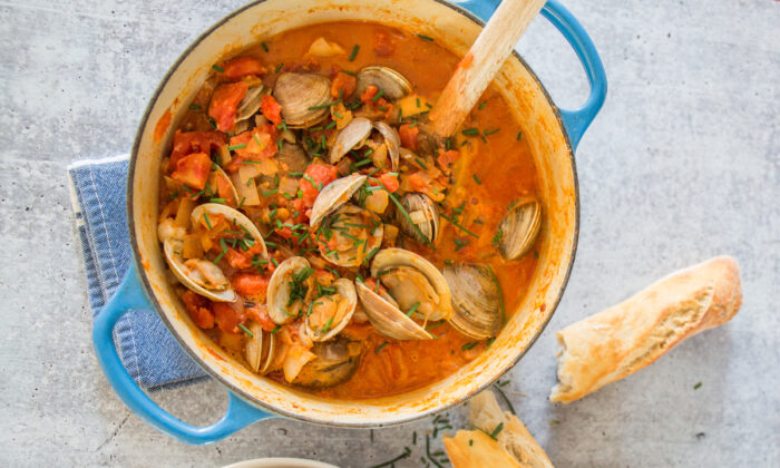 Chorizo, canned tomatoes, and a touch of cream upgrade a basic pot of clams into a satisfying supper. (Caroline Chambers)
