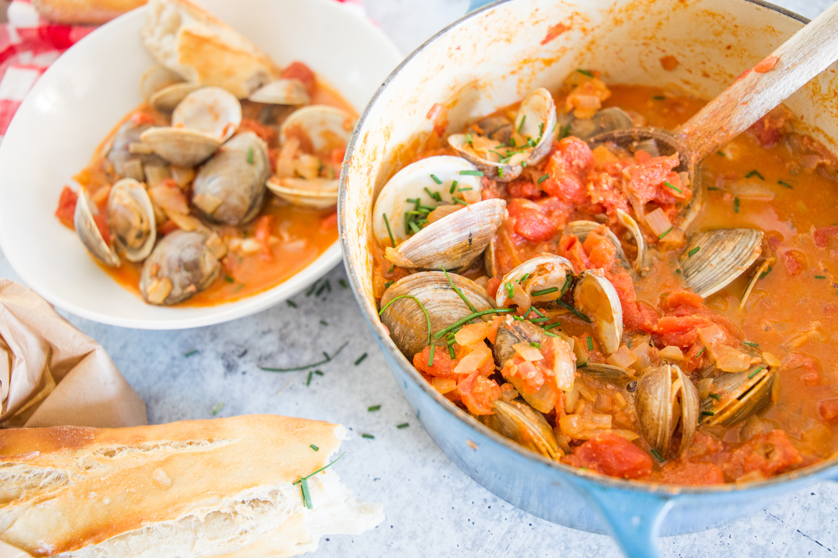creamy tomato and chorizo clams in pot and bowl