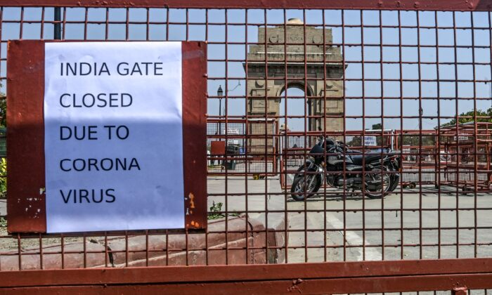 A print-out pasted on a police barricade informs about the closure of the India Gate amid concerns over the spread of COVID-19 novel coronavirus, in New Delhi on March 19, 2020. (Sajjad Hussain/AFP via Getty Images)