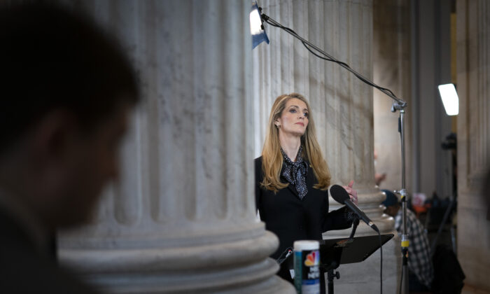 Sen. Kelly Loeffler (R-Ga.) does a television interview after a Senate GOP lunch meeting in the Russell Senate Office Building on Capitol Hill in Washington on March 20, 2020. (Drew Angerer/Getty Images)
