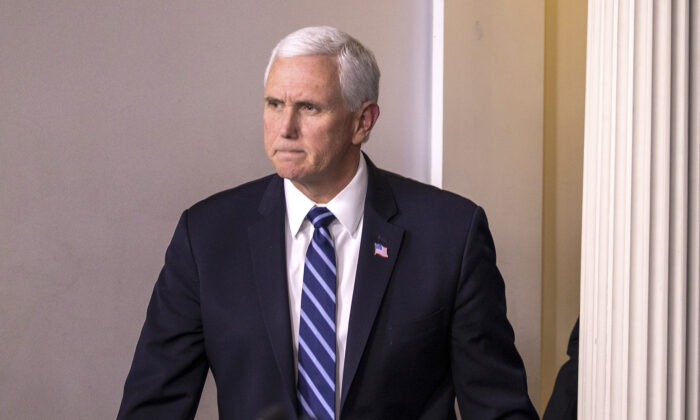 Vice President Mike Pence arrives for a briefing on the Trump administration's CCP virus response in the press briefing room of the White House in Washington on March 4, 2020. (Tasos Katopodis/Getty Images)