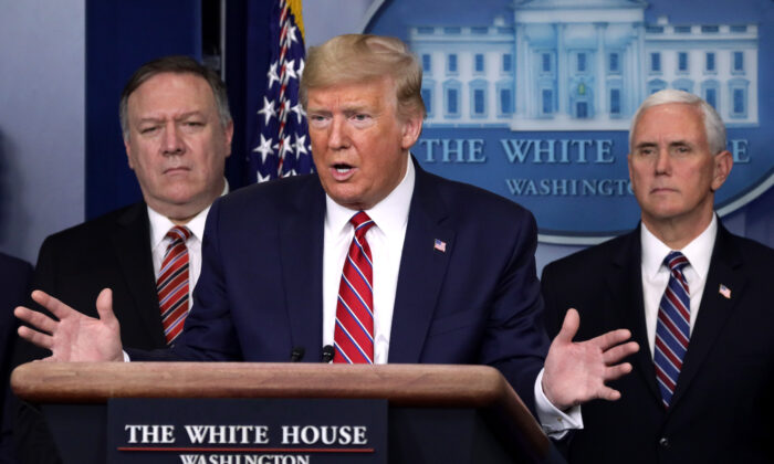 President Donald Trump speaks as Secretary of State Mike Pompeo and Vice President Mike Pence listen during a news briefing on the latest development of the coronavirus outbreak in the United States at the James Brady Press Briefing Room at the White House in Washington on March 20, 2020. (Alex Wong/Getty Images)