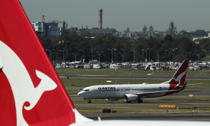 A Qantas aircraft prepares to take off from the international terminal of Sydney Airport on March 19, 2020 in Sydney, Australia. (Mark Metcalfe/Getty Images)
