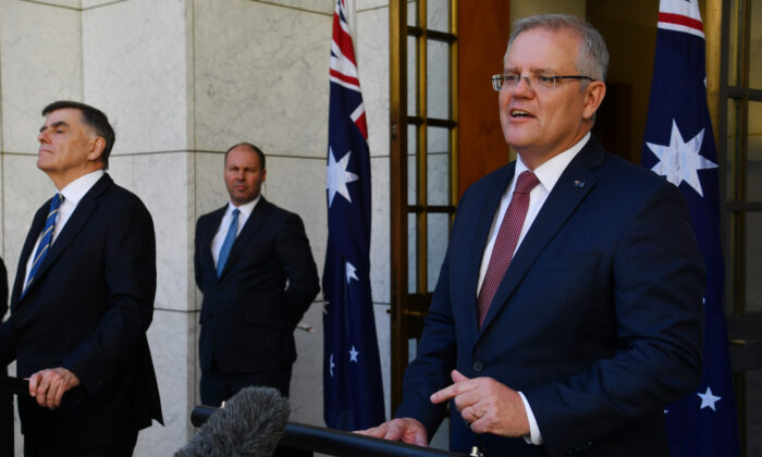 Prime Minister Scott Morrison (right), Treasurer Josh Frydenberg and Chief Medical Officer for the Australian Government Professor Brendan Murphy (left) address the media following a Cabinet meeting at Parliament House in Canberra, Australia on March 20, 2020. (Sam Mooy/Getty Images)