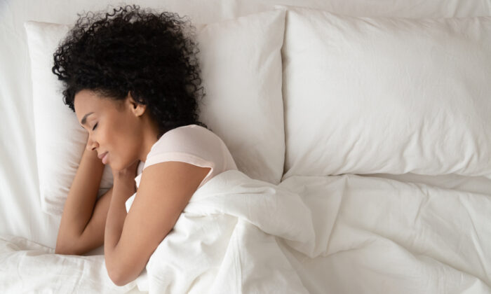 Allow yourself plenty of time to wind down, disconnect from digital devices, and enjoy deep, restorative sleep. (fizkes/Shutterstock)