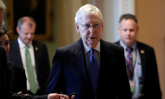 U.S. Senate Majority Leader Mitch McConnell (R-Ky.) speaks to members of the news media while walking into his office on Capitol Hill in Washington on March 17, 2020. (Tom Brenner/Reuters)