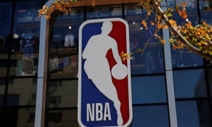 An NBA logo is seen on the facade of its flagship store at the Wangfujing shopping street in Beijing, China, on Oct. 8, 2019. (Tingshu Wang/Reuters)