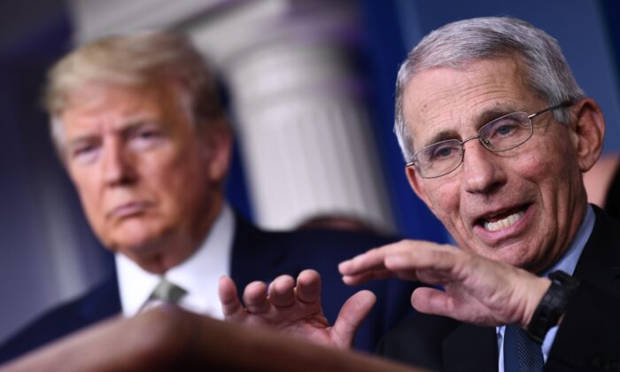 Dr. Anthony Fauci speaks as President Donald Trump listens during the daily press briefing on the Coronavirus pandemic situation at the White House in Washington on March 17, 2020. (Brendan Smialowski/AFP via Getty Images)