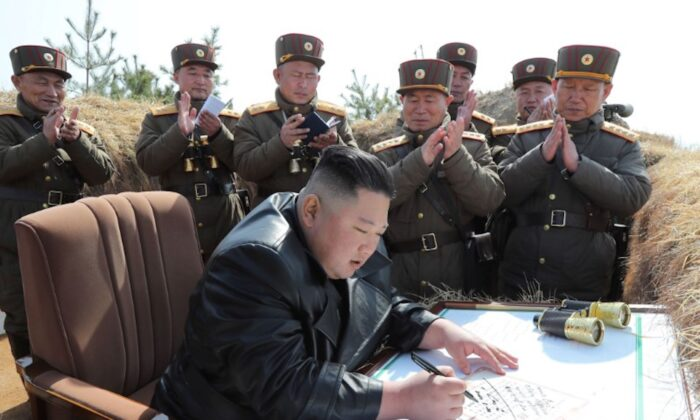 North Korean leader Kim Jong Un guides artillery fire competition in this image released by North Korea's Korean Central News Agency on March 20, 2020. (KCNA via Reuters)