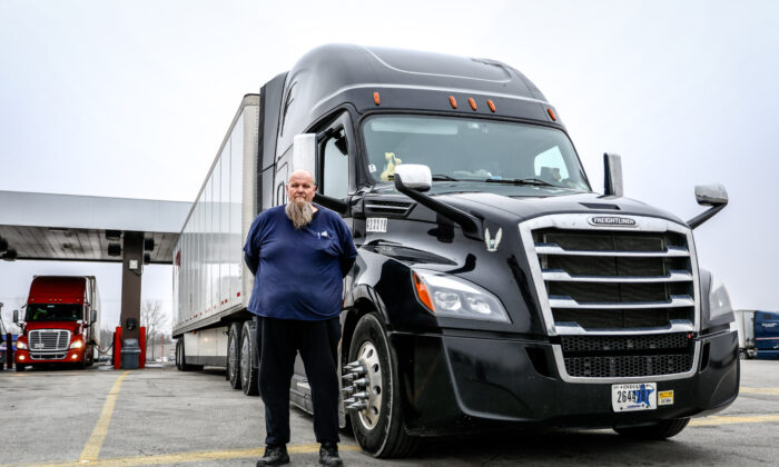 Truck driver Randy Griffith stands next to his Freighliner at the TA Truck Service truck stop in London, Ohio, on March 19, 2020. (Charlotte Cuthbertson/The Epoch Times)
