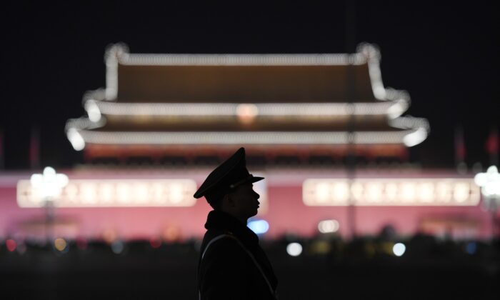 A paramilitary police officer stands guard in Tiananmen Square in Beijing, China, on March 11, 2018. (Greg Baker/AFP via Getty Images)