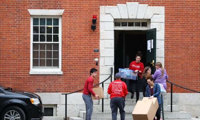 Students move out of dorm rooms on Harvard Yard on the campus of Harvard University in Cambridge, Mass. on March 12, 2020. Due to the risk from the CCP virus, all classes will be moved online for the rest of the spring semester. (Maddie Meyer/Getty Images)