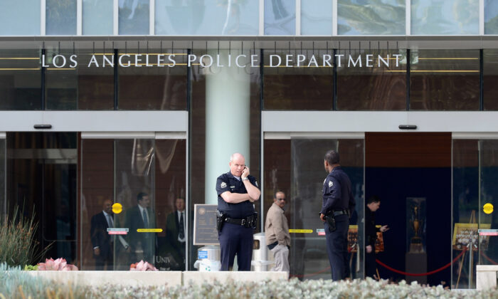 Los Angeles Police Department officers are deployed around the police headquarters  in Los Angeles, Calif., on Feb. 7, 2013. (Kevork Djansezian/Getty Images)
